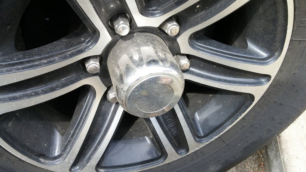 remove plastic cap on axle