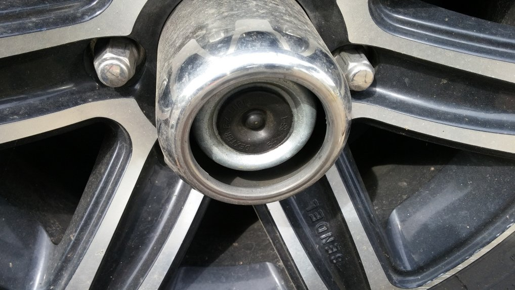 remove rubber cap on axle
